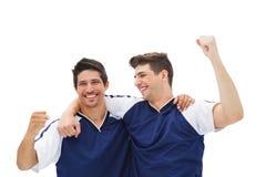 Giocatori di football americano che celebrano una vittoria Immagine Stock