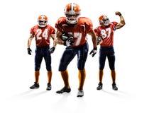 Giocatori di football americano dentro actionisolated su bianco immagini stock