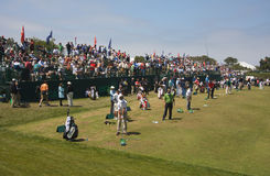 Giocatori di golf della vigilanza dei ventilatori di golf Immagini Stock
