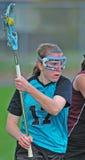 Giocatori di Lacrosse con la sfera Fotografie Stock Libere da Diritti