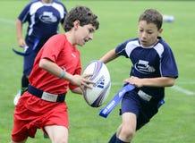 Giocatori di rugby dei bambini Fotografia Stock