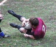 Giocatori di rugby nell'azione Fotografie Stock Libere da Diritti