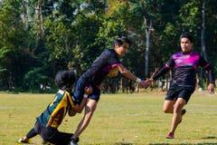 Giocatori di rugby nell'azione fotografia stock