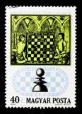 Giocatori di scacchi dal manoscritto del XV secolo, cinquantesimo anniversario di Fotografia Stock Libera da Diritti