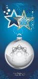 Giocattoli brillanti di Natale su fondo decorativo blu scuro Fotografia Stock
