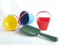 Giocattoli della sabbiera con spazio per testo Fotografia Stock