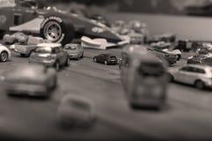 Giocattoli delle automobili su un fondo di legno Fotografia Stock
