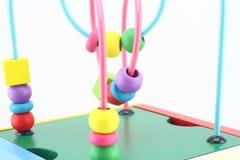 Giocattoli di legno, gioco di sviluppo per i bambini Fotografie Stock