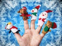Giocattoli di Natale messi su una mano Fotografia Stock Libera da Diritti