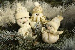 Giocattoli di Natale sotto forma di pupazzi di neve Fotografia Stock