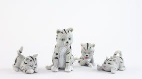 Giocattoli di plastica del gatto Fotografie Stock