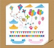 Giocattoli e decorazioni differenti sul fondo del cartone Fotografia Stock Libera da Diritti