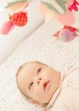 Giocattoli pieni d'ammirazione del neonato Fotografie Stock Libere da Diritti