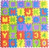 Giocattoli variopinti di numeri delle lettere Fotografia Stock