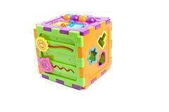 Giocattolo astuto del cubo del bambino di plastica isolato su bianco Immagini Stock Libere da Diritti