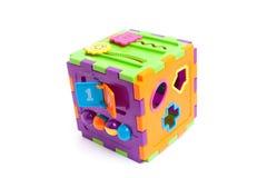 Giocattolo astuto del cubo del bambino di plastica isolato su bianco Immagine Stock Libera da Diritti