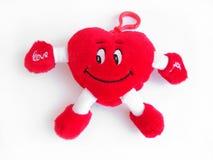Giocattolo - cuore rosso nella priorità bassa bianca Fotografie Stock Libere da Diritti