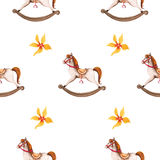 Giocattolo del cavallo dell'oscillazione e modello senza cuciture dei fiori Immagine Stock Libera da Diritti