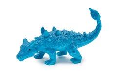 Giocattolo del dinosauro della plastica o del silicone isolato su fondo bianco Fotografie Stock Libere da Diritti