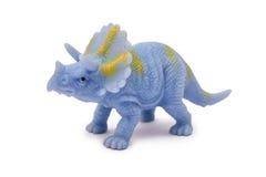 Giocattolo del dinosauro della plastica o del silicone isolato su fondo bianco Fotografia Stock