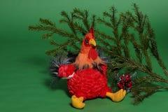 Giocattolo del gallo con il ramo attillato Fotografie Stock Libere da Diritti