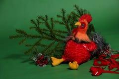 Giocattolo del gallo con il ramo attillato Fotografia Stock