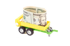 Giocattolo del rimorchio dei bambini gialli con il dollaro Immagine Stock Libera da Diritti