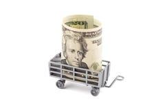 Giocattolo del rimorchio dei bambini grigi con il dollaro Fotografia Stock Libera da Diritti