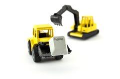 Giocattolo dell'escavatore e del bulldozer con la chiave domestica Immagini Stock