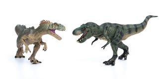 Giocattolo di allosauro e di tirannosauro su fondo bianco Immagini Stock