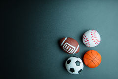 Giocattolo di calcio, giocattolo di baseball, giocattolo di pallacanestro ed isolato del giocattolo di rugby Fotografia Stock