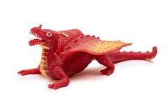 Giocattolo di plastica del drago isolato su fondo bianco Fotografia Stock