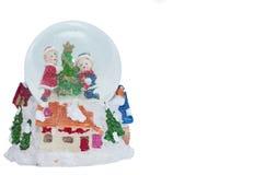 Giocattolo di vetro della palla della neve - pupazzo di neve - fondo bianco Fotografia Stock Libera da Diritti
