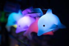 Giocattolo fluorescente del delfino Immagini Stock Libere da Diritti