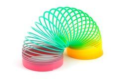 Giocattolo Slinky sopra bianco Fotografie Stock