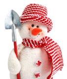 Giocattolo sorridente del pupazzo di neve con la pala immagine stock libera da diritti