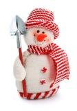 Giocattolo sorridente del pupazzo di neve vestito in sciarpa e protezione fotografie stock