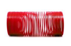 Giocattolo sping rosso isolato Fotografie Stock