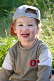 Giochi da bambini belli ad un'erba Fotografia Stock Libera da Diritti