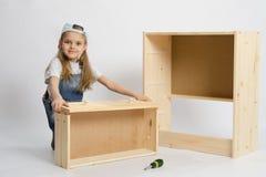 Giochi da bambini nella mobilia del costruttore Immagine Stock