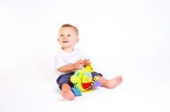 Giochi del bambino con i giocattoli Fotografia Stock Libera da Diritti