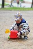 Giochi del ragazzo Fotografia Stock
