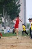Giochi dell'atletica leggera dell'allievo il salto triplice Immagini Stock Libere da Diritti