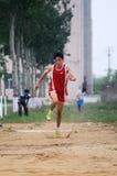 Giochi dell'atletica leggera dell'allievo il salto triplice Immagine Stock Libera da Diritti