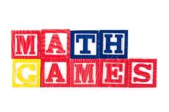 Giochi di per la matematica - blocchetti del bambino di alfabeto su bianco Fotografia Stock Libera da Diritti