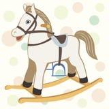 Giochi il cavallo a dondolo per un bambino sui precedenti allegri delicati Immagini Stock
