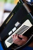 Giochi la fisarmonica Fotografia Stock