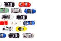 Giochi le automobili con la vista superiore su fondo bianco Fotografia Stock