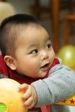 Gioco asiatico del bambino Fotografia Stock Libera da Diritti