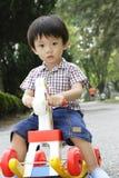Gioco asiatico del ragazzo Fotografia Stock Libera da Diritti